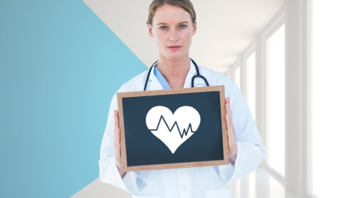 Portrait of doctor holding a slate board in hallway